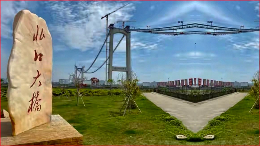 瓯江北口大桥是三塔四跨双层钢桁梁悬索桥